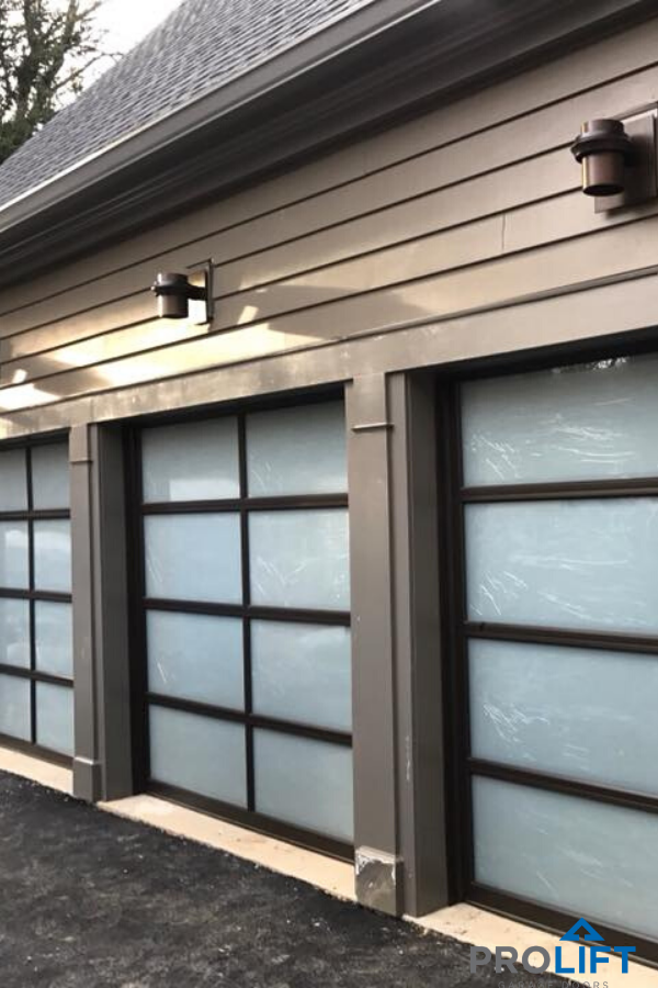 Glass Garage Doors With Powder Coated Aluminum Frames And Insulated Frosted Glass In 2020 Glass Garage Door Garage Doors Contemporary Garage Doors