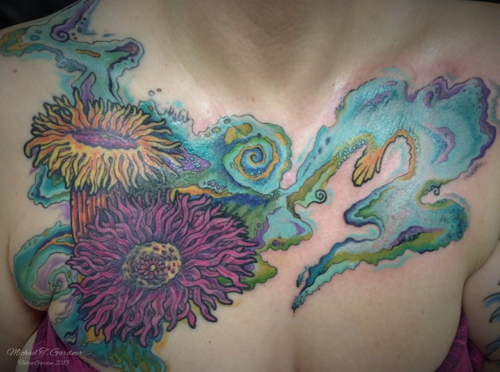 Abstract water and anemones coverup on chest