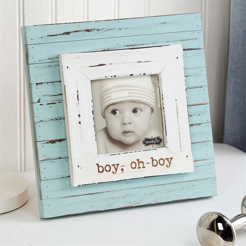 Multi-planked, distressed frame features layered border around 3 1/2 ...