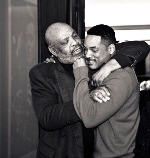 The late James Avery showing some Uncle Phil love to Will Smith.