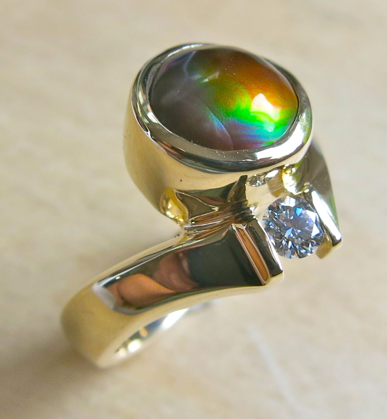 One of a kind 14K yellow gold fire agate and diamond ring by Glenn Dizon Designs.  Available, PM my Fb page, Glenn Dizon Designs