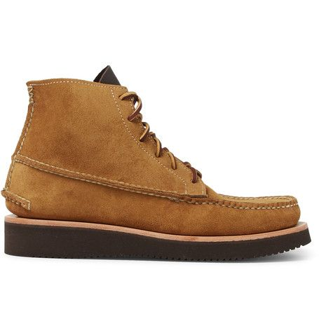 <a href='http://www.mrporter.com/mens/Designers/Yuketen'>Yuketen</a>'s American-made boots are inspired by the close-fitting, pliable shoes worn by the early wilderness guides of New England. The classic, true-moccasin construction delivers the insulation, comfort and silent tread that explorers and indigenous hunters required. The oil-resistant Vibram® soles provide a solid footing and bring a modern update to the design.