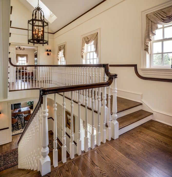 80 Modern Farmhouse Staircase Decor Ideas 64: Traditional Open And Bright Staircase With Wrought Iron