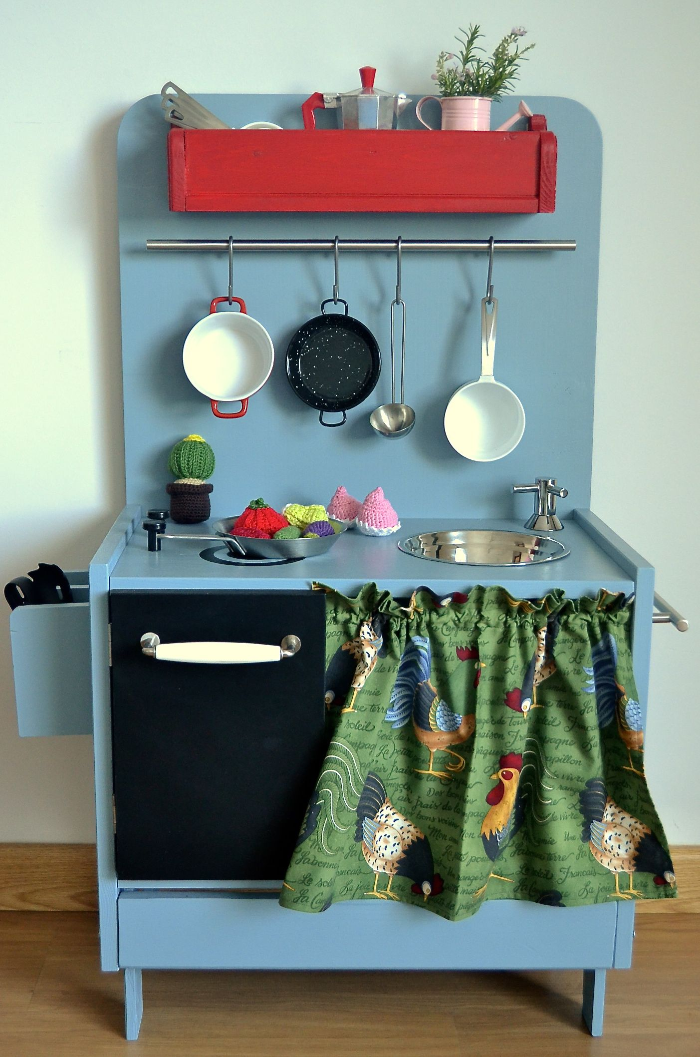 Wooden play kitchen - made from a spanish company, I think, so cute ...