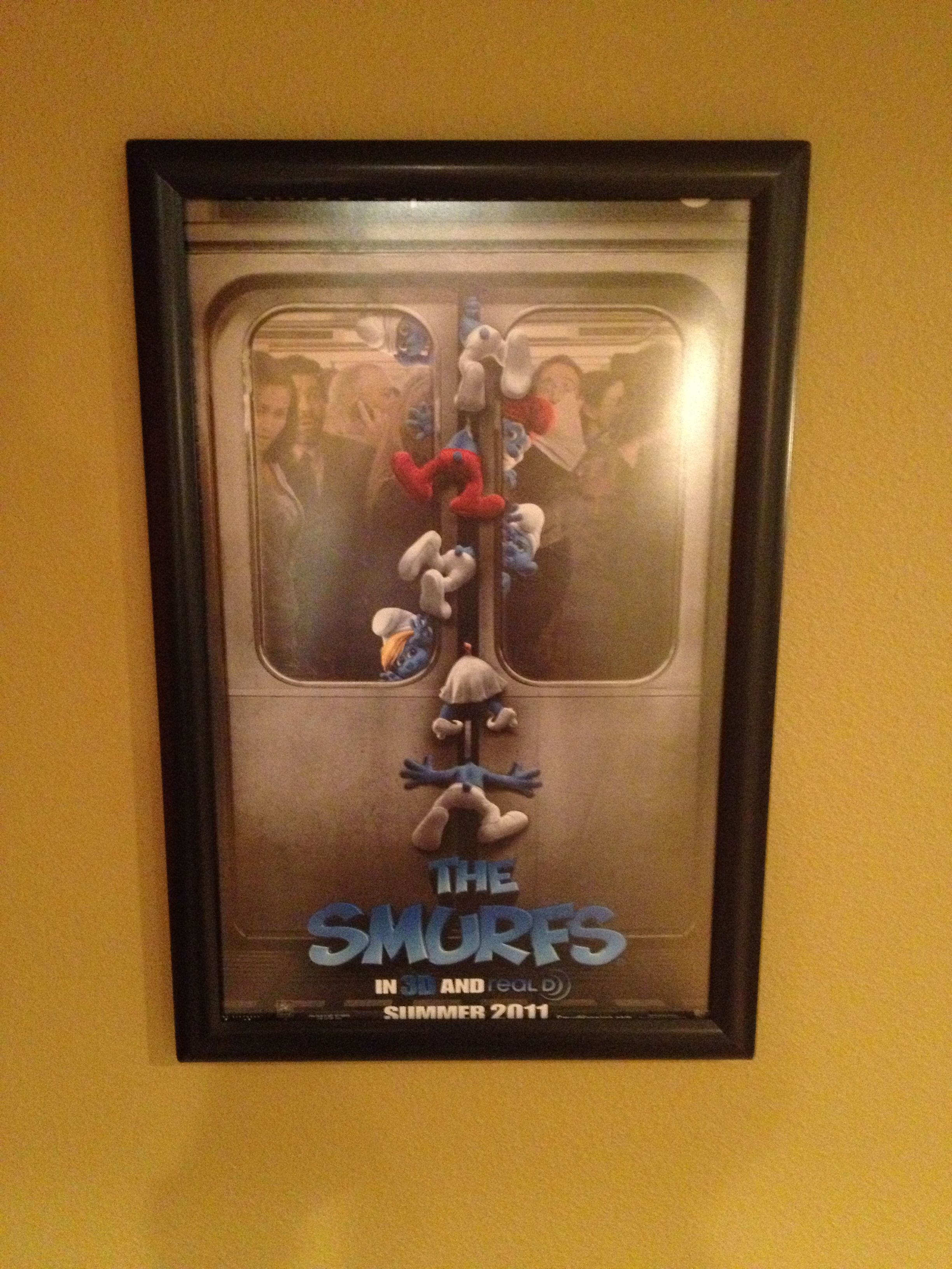 The Smurfs Movie Poster In Its 11x17 Black Aluminum Anti Glare Snap