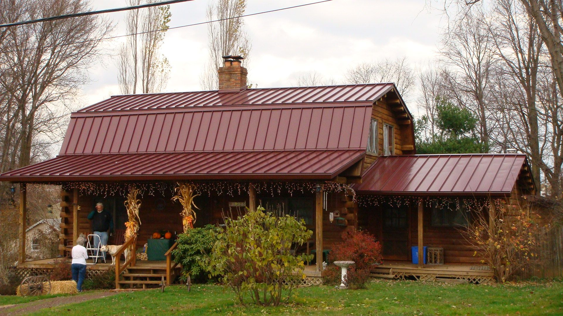 Metal roof and barn style log home metal building for Metal roof home plans