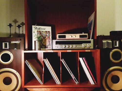 My husband would definitely have a turntable and a place to store his vintage vinyls... He's a little more modern and electric in his tastes. That's a musician for you.
