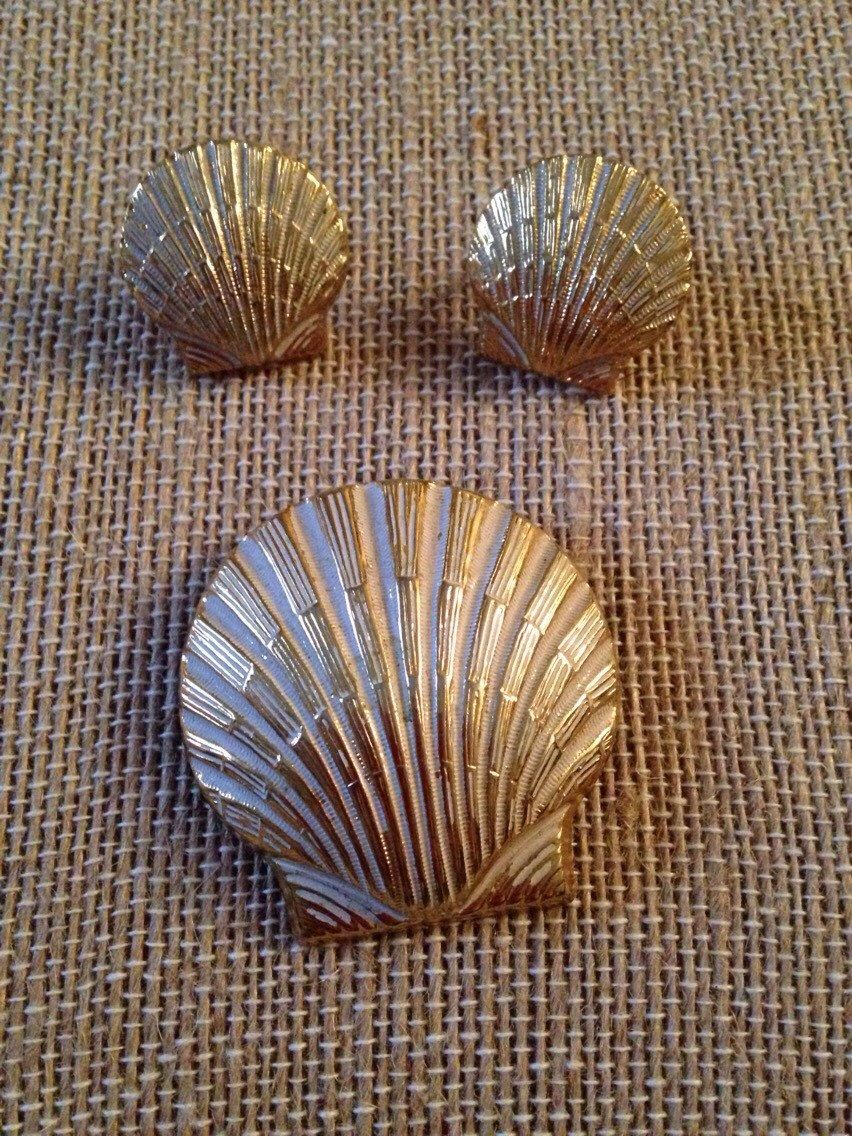 A personal favorite from my Etsy shop https://www.etsy.com/listing/263837837/vintage-seashell-brooch-and-earrings-set