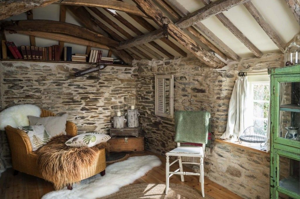 21 reading nooks that are too cozy for words | Sheepskin throw and