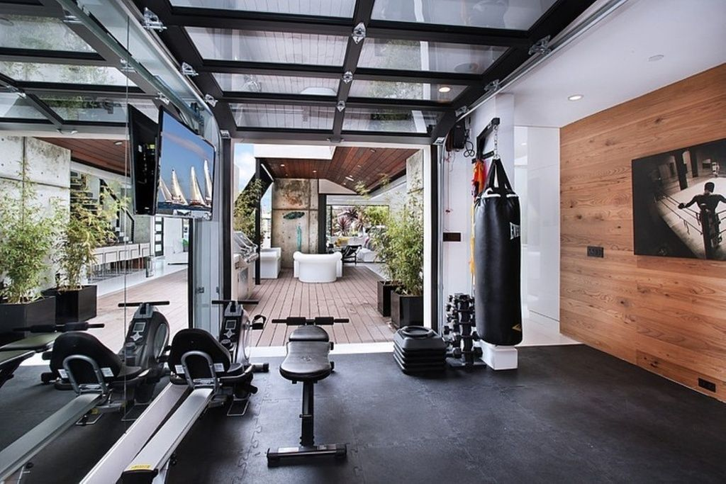 Contemporary home gym with can lights standard height