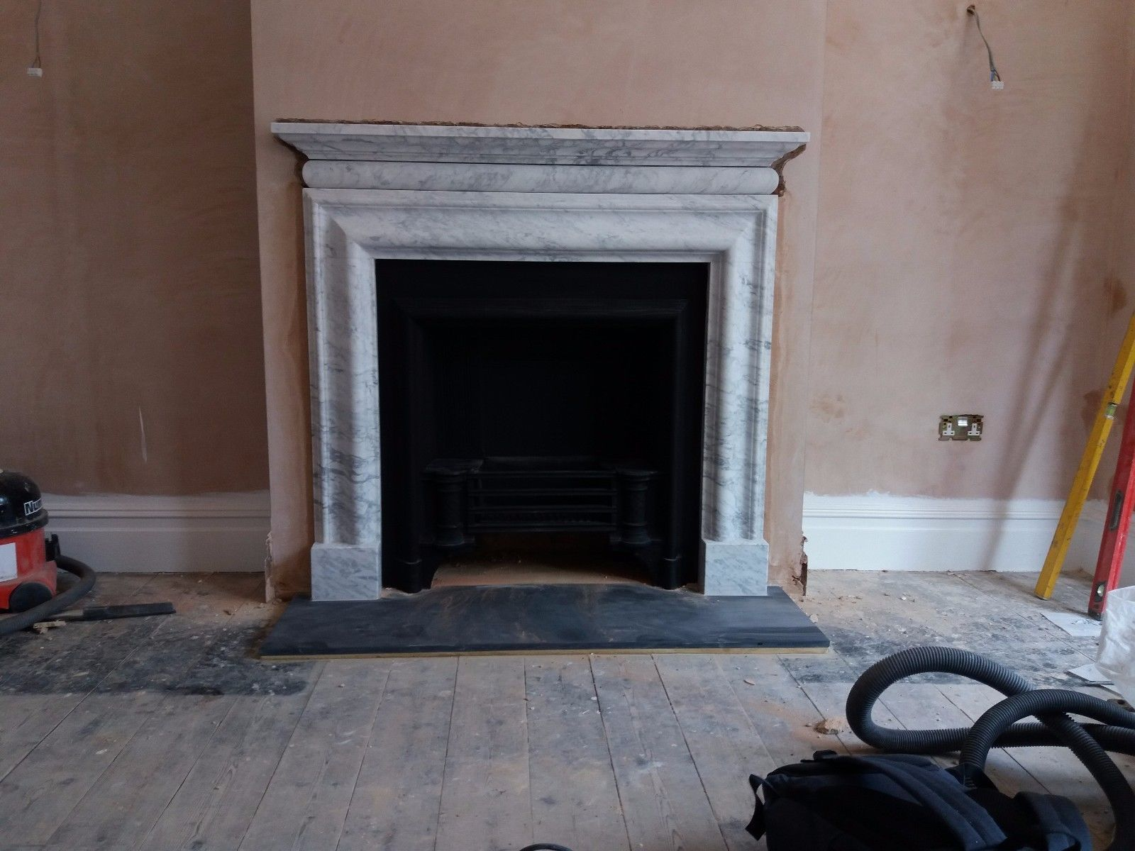 a bolection fireplace surround in high quality italian white carrara