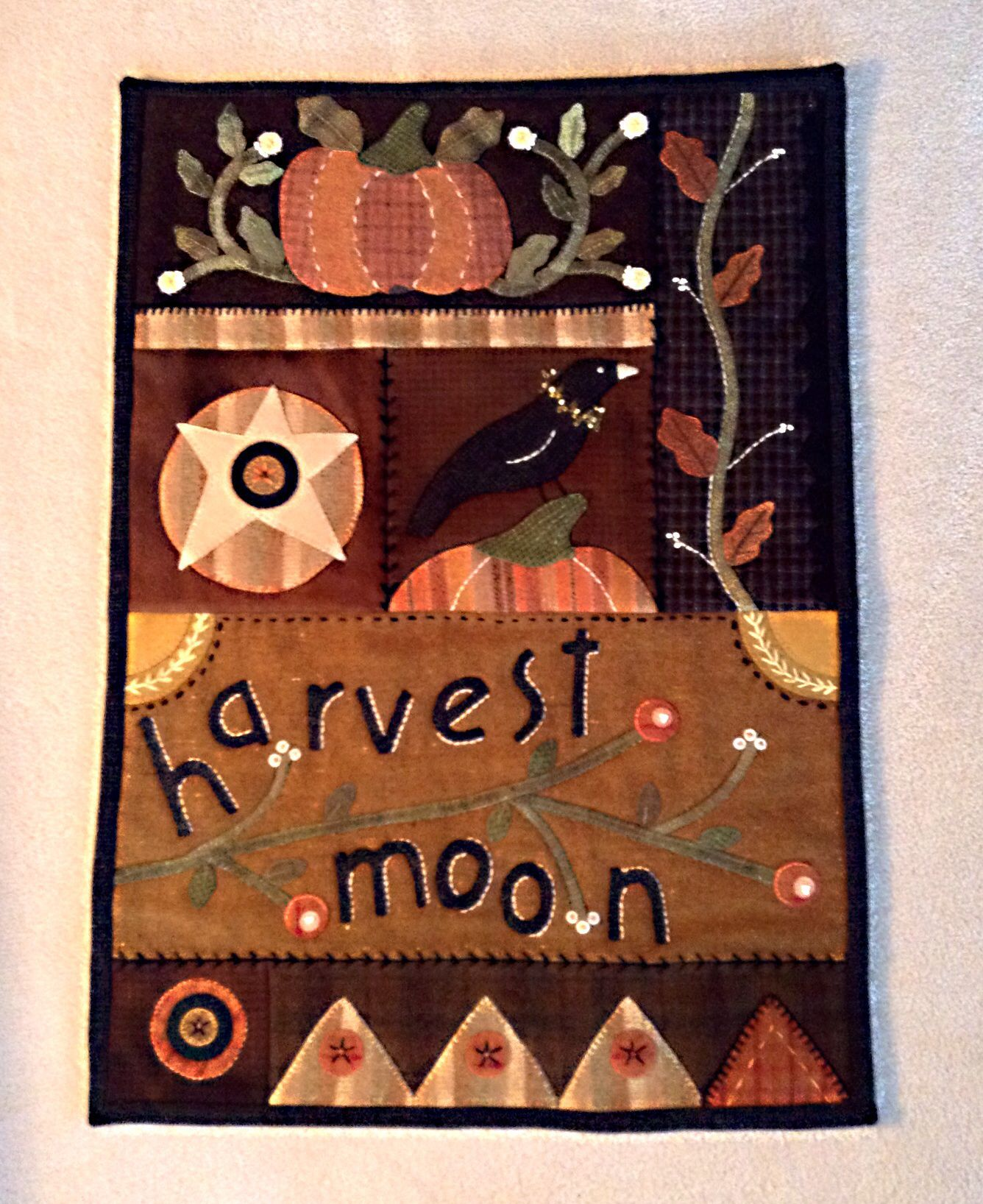 Harvest moon. Hand wool appliqué and stitch embellishment on wool. 2013