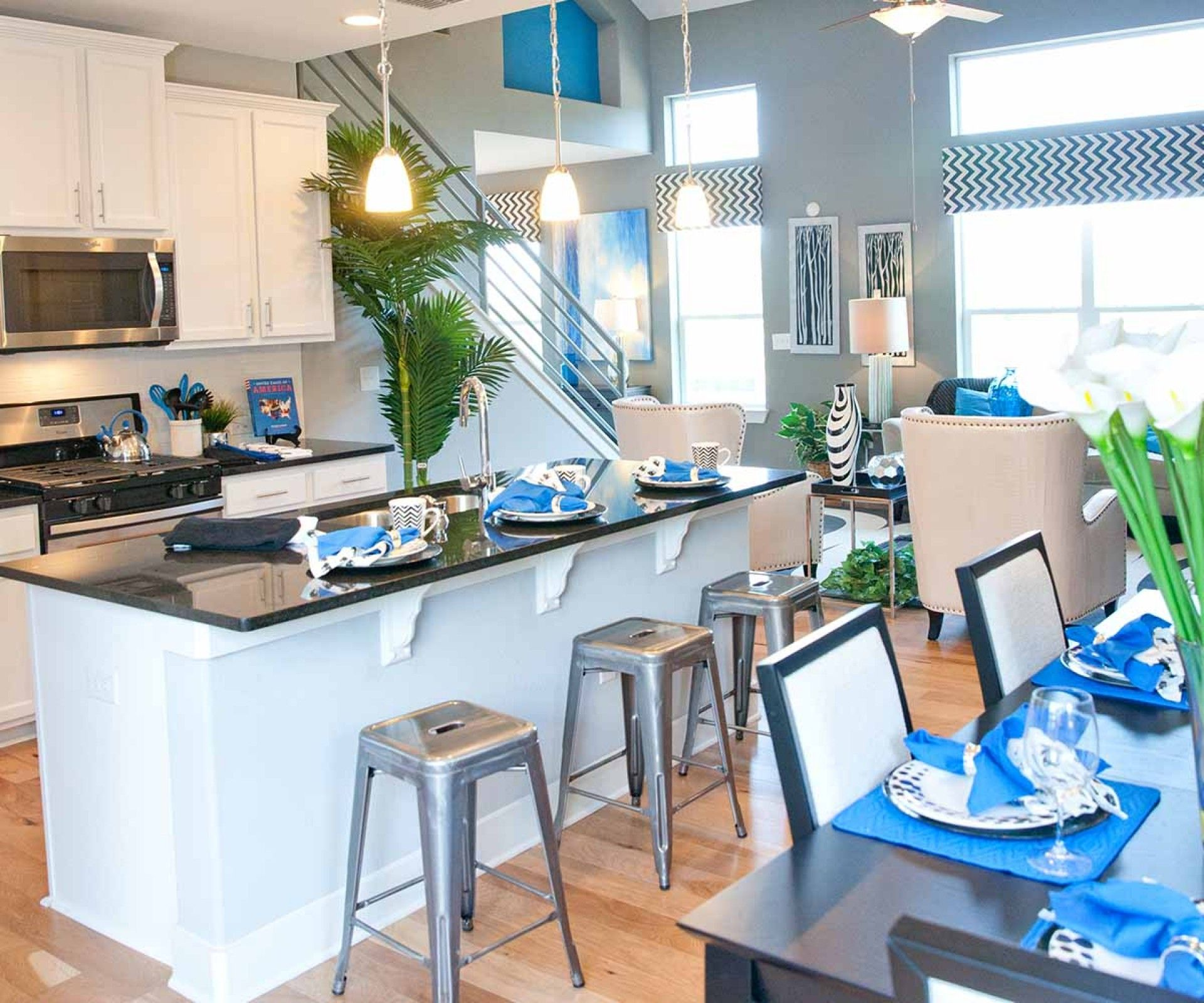 Fall in love with this modern kitchen with bright blues and accents ...