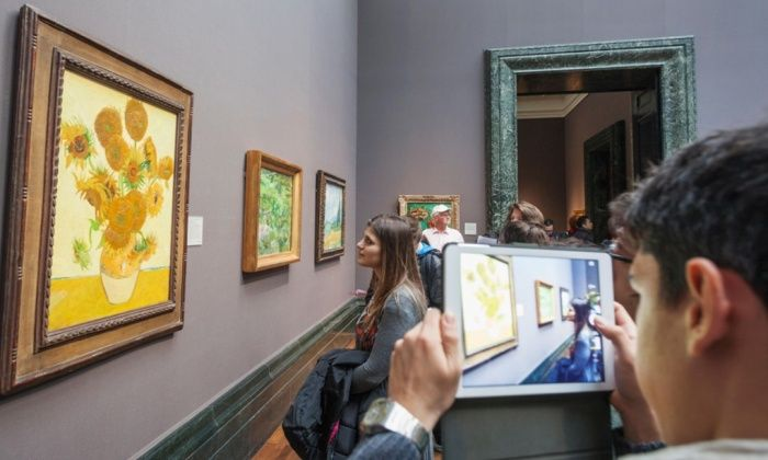 The National Gallery, visitors and painting titled Sunflowers by Vincent Van Gogh