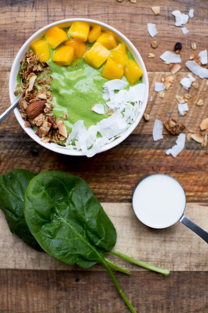My favorite smoothie of the moment: this quick and fun-to-eat tropical green smoothie bowl! Serve it in a bowl for a nutritious breakfast or lunch, or pour it into a mason jar and take it to go! #sponsored #recipe #smoothie