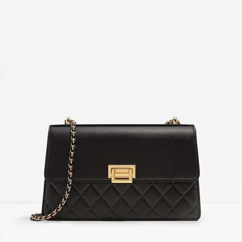 Boxy mid-sized quilted shoulder bag with push-lock closure and a ...