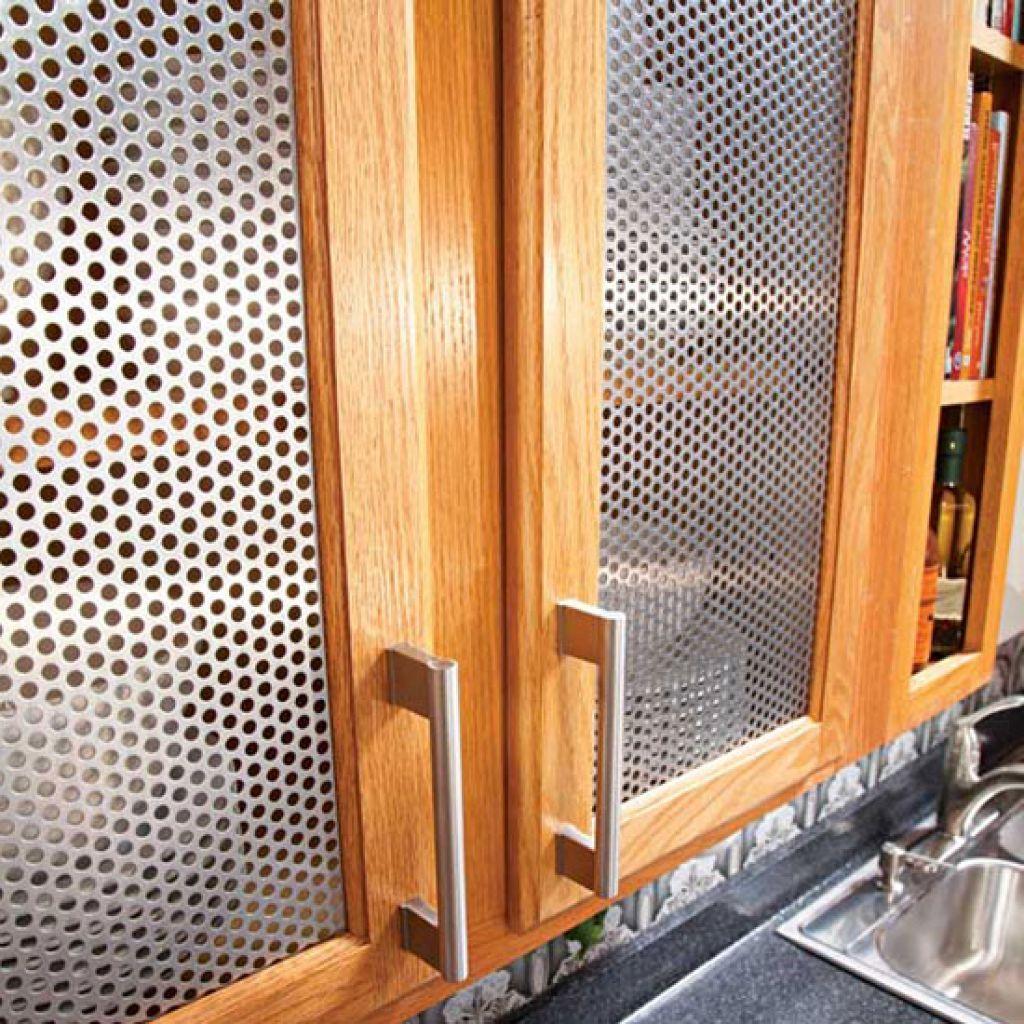 Metal kitchen cabinet door inserts with low angled handle and metal kitchen cabinet door inserts with low angled handle and using holey metal for the door cover planetlyrics Images