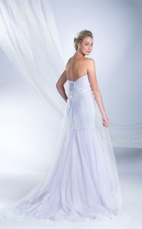 53f3e24a7f86 This cage-style wedding gown inspired by Rapunzel reflects optimism, joy  and grace