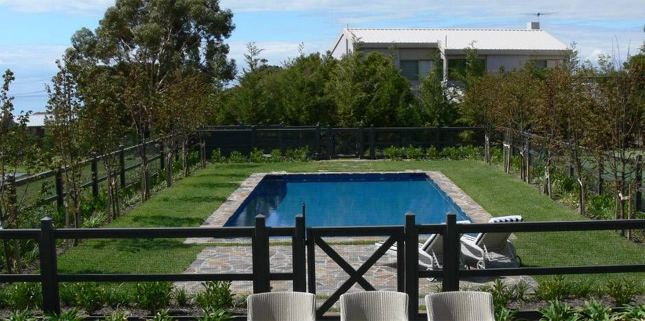 If you are looking for a less obtrusive type of pool fencing that