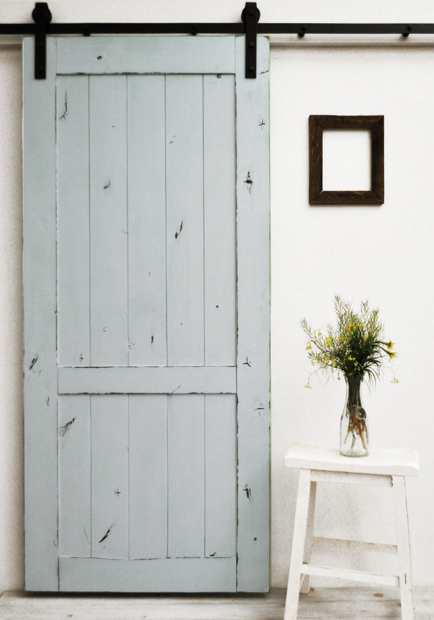 A lightly distressed finish on a classic barn door design Like Mama always said