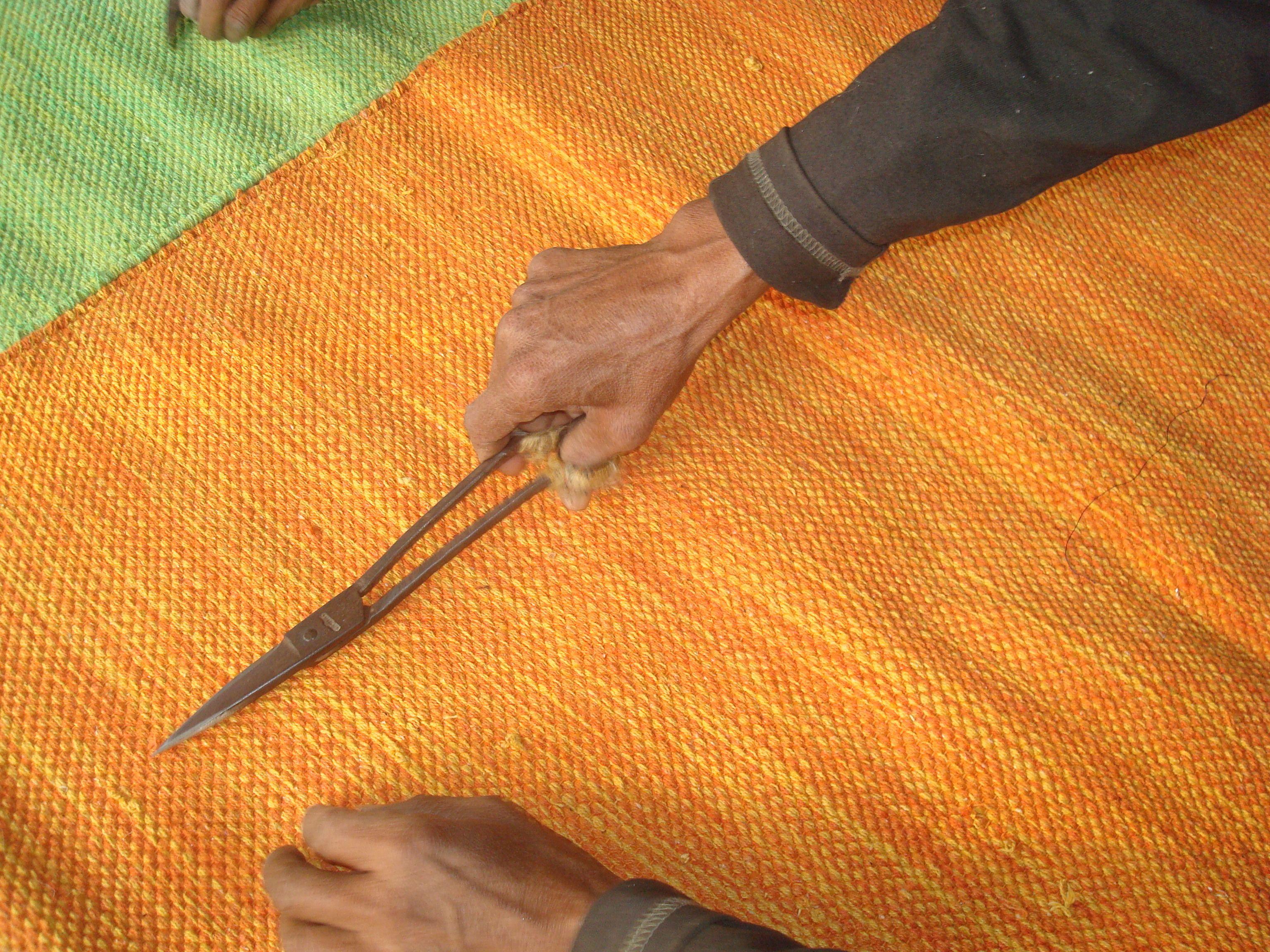Skilled hands making a fire mat