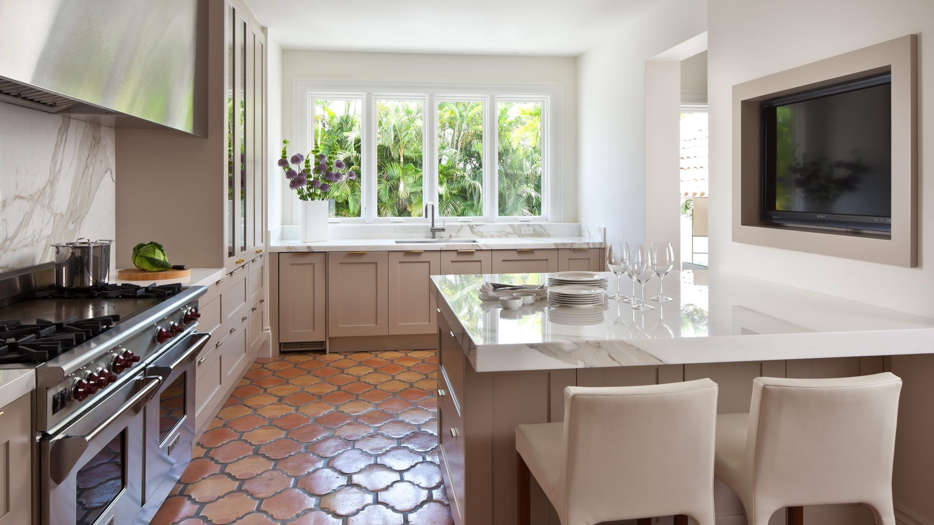 Cool grey painted cabinetry warm terracotta tile floors marble cool grey painted cabinetry warm terracotta tile floors marble slab bright white walls dailygadgetfo Images