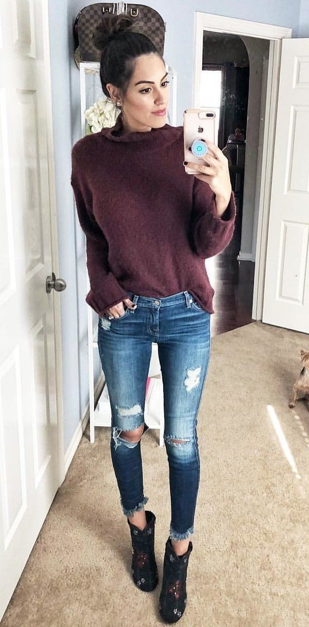 297438cd524  winter  outfits women s purple sweater and blue distress jeans. Click To  Shop This Look.
