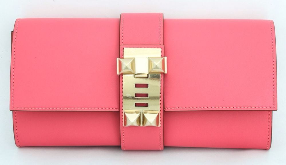 2d122d29f026 Where wouldn t you take your Hermes Medor clutch