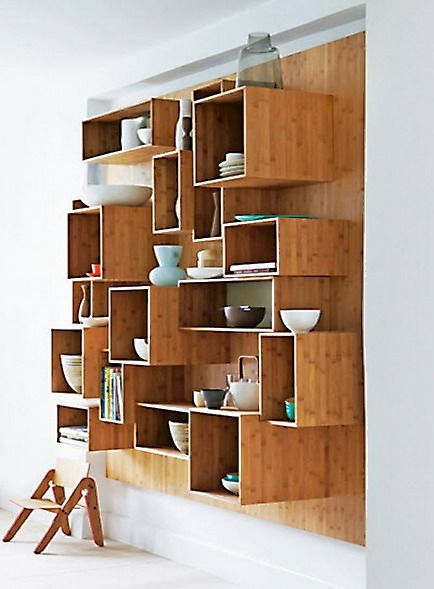 {Wall of Wooden Shelving Blocks} this is such a fab idea! totally want to duplicate it!