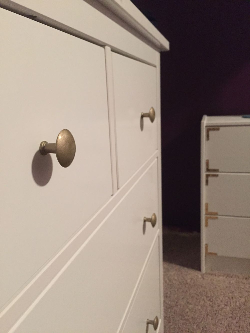A little gold spray paint on the Ikea Hemnes dresser knobs, and it ...