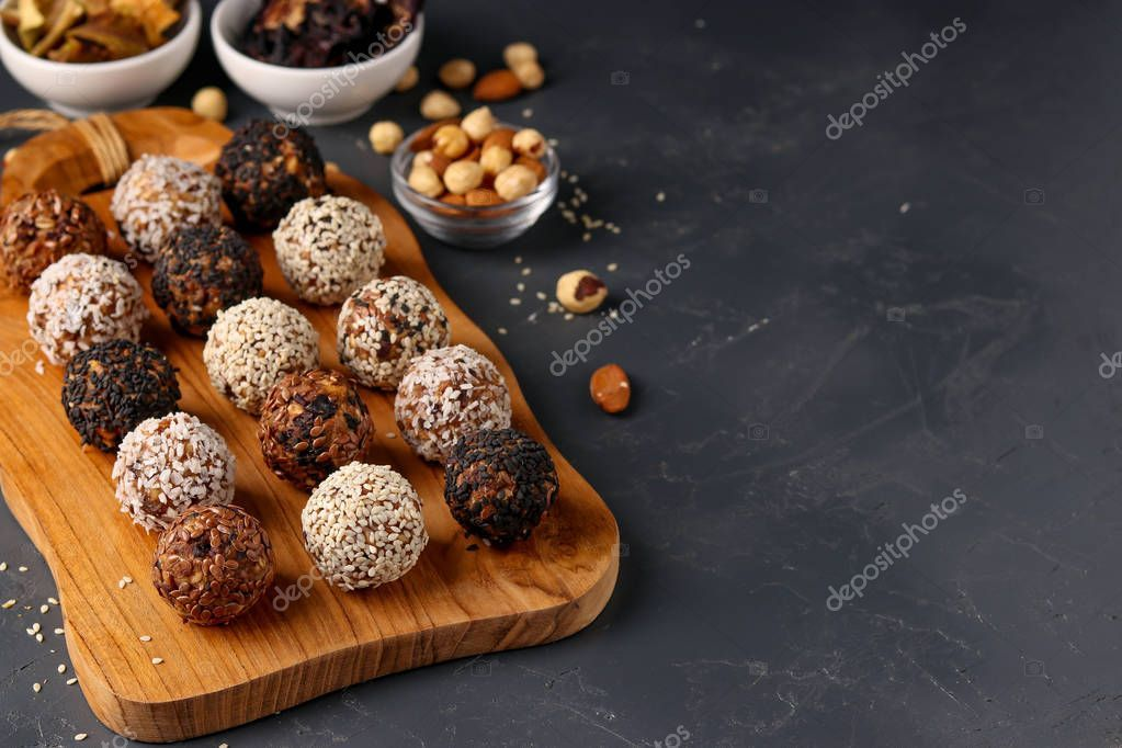 Energy Balls Of Nuts Oatmeals And Dried Fruit On Wooden Board On