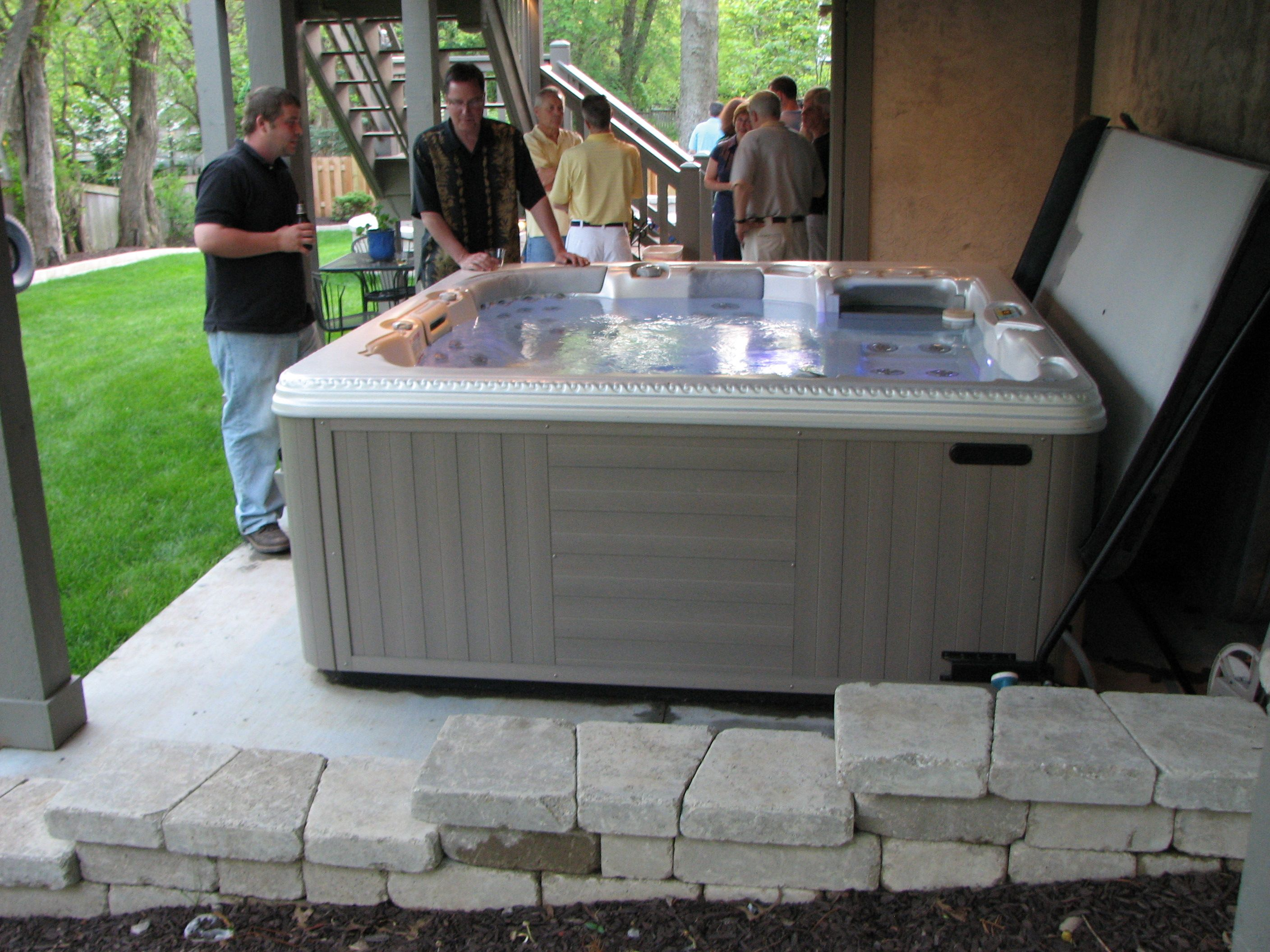 Hot tub fits neatly under a tall deck and is connected to the ...