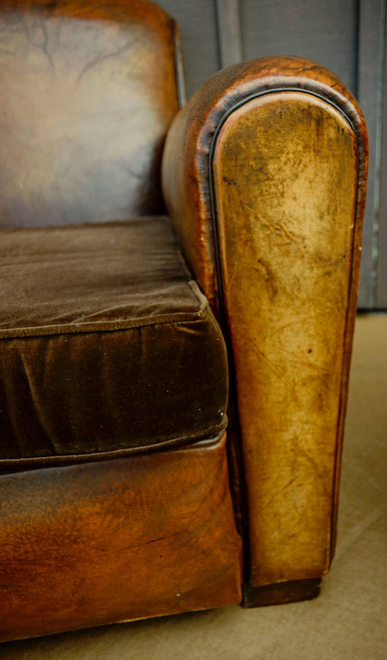 pair of french leather club chairs with velvet cushions | leather