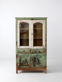 circa 1800s This is an American wood pie safe or cupboard. The wood cabinet features a glass door shelved top with perforated tin sides. The base of the cabinet opens with two doors to a shelved inter