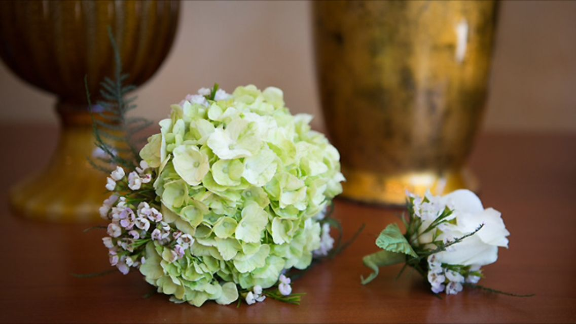 Simple bouquet and boutineer. Day time civil ceremony at home.