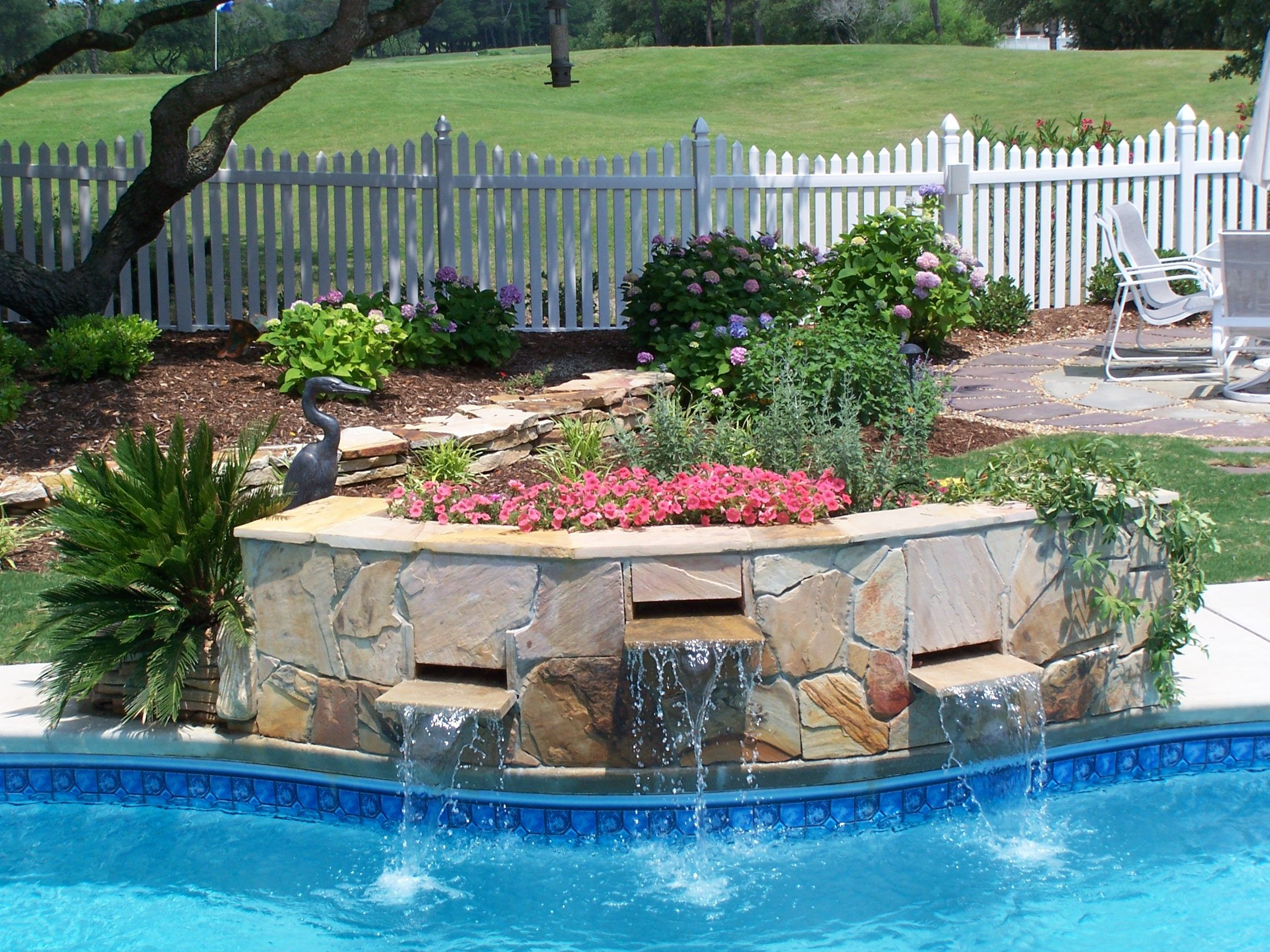 Pool waterfall planter sandscapes pinterest pool for Pool waterfall