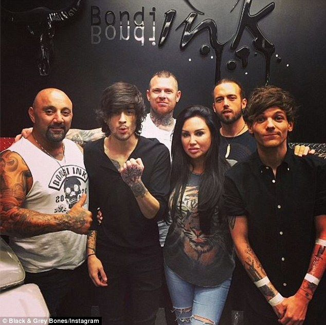 New ink: One Direction members Zayn Malik (second from left