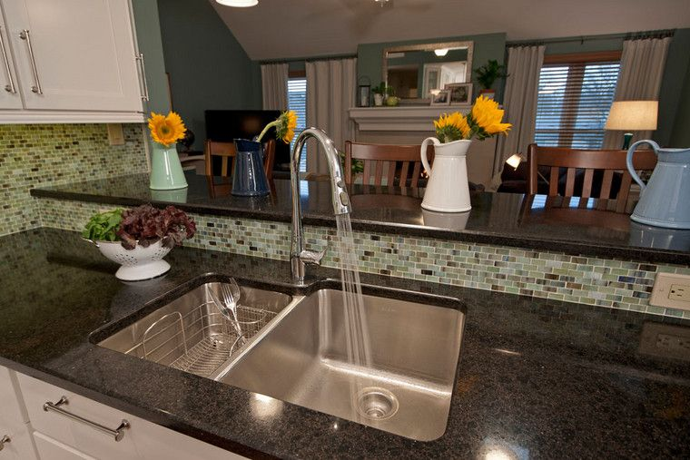 The Dark Quartz Countertop Frames An Elkay Double Bowl Sink. The Sink Comes  With A
