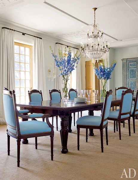 A Dining Room Is Enlivened By An Ornate Chandelier And South African Chairs Upholstered In