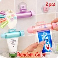 Wish | 2pcs ABS Rolling Squeezer Toothpaste Dispenser Tube Partner Sucker Hanging Holder