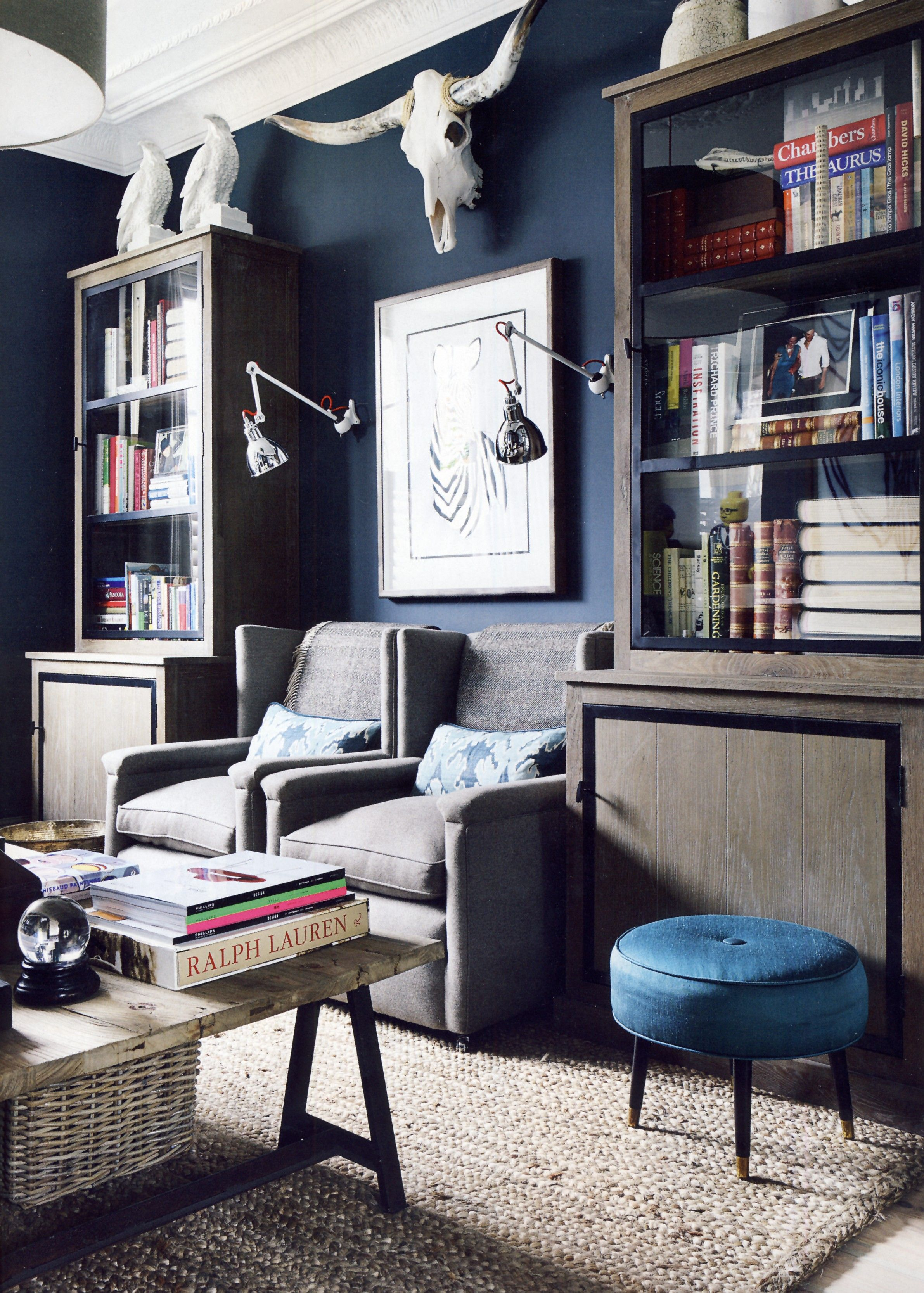Navy blue den white crown grey brown rug leather couch bar antler chandalier bam also inside the homes of interior designers living room space and sofa rh pinterest