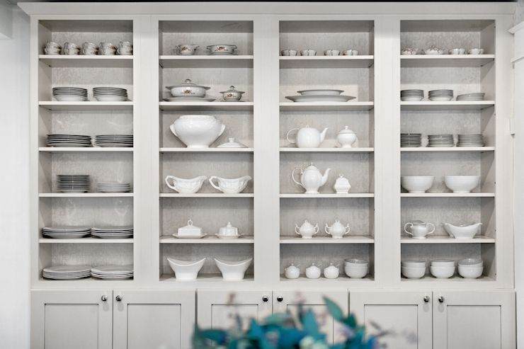 Dining room boasts light gray built-in china cabinet ...