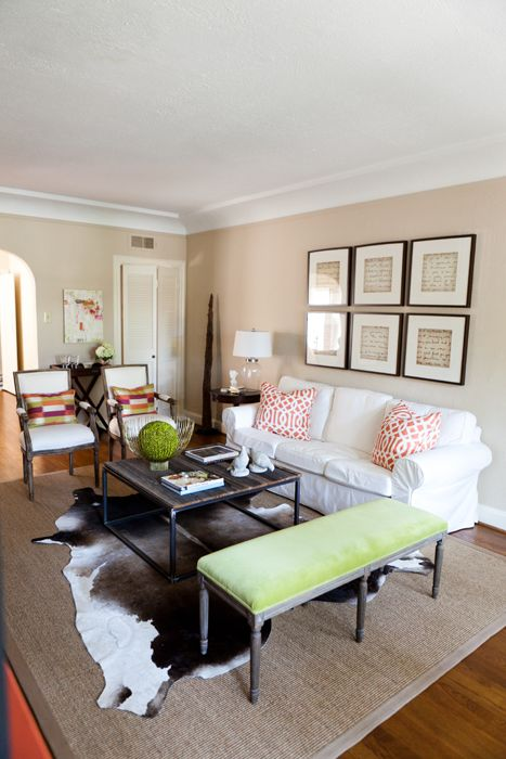 White Sofa Layered Rugs With A Cowhide And Dark Espresso Furniture Like The Frame Grouping