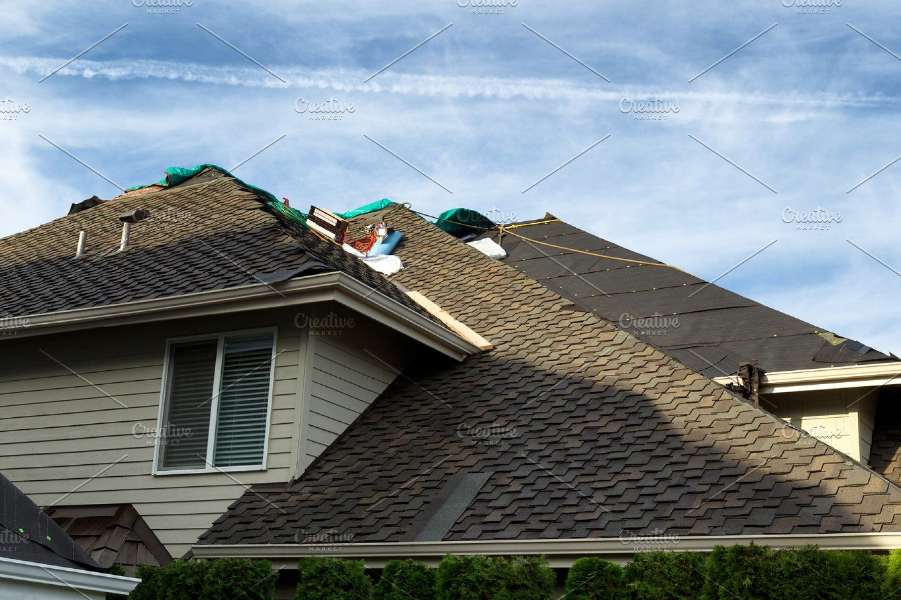 New Roof Being Put On Home Roof Replacement Cost Roofing Cool Roof