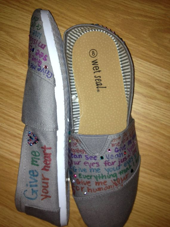 Hand painted and written TOMS (The pictures aren't of TOMS but the product would be) can be done in any color combination and have any saying. The ones shown have Scripture and songs on them, however they can have whatever you would like. Any color gem can be added to add some sparkle to your new custom TOMS! Choose your size and color of TOMS that you want and then contact me and let me know what color you want and what saying, verse or song you want. Shipped by USPS  $75.00