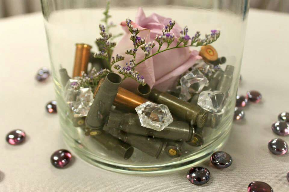 Gun themed wedding using spent shell casings roses and