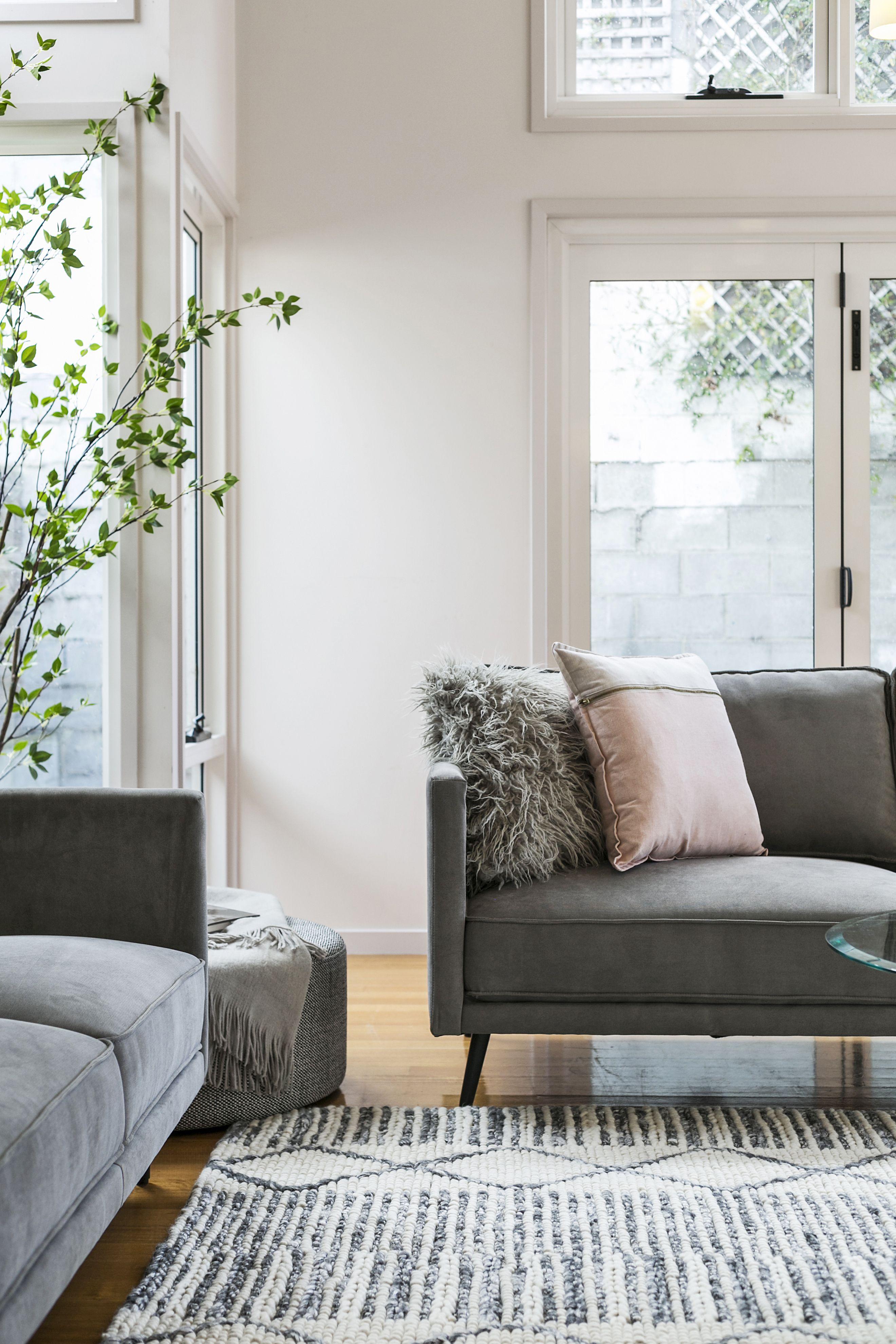 Grey Sofa With Pink Cushions Textured Floor Rug Polished Floor Boards Plants Add Life Grey Sofa Living Room Home Living Room Living Room Sofa
