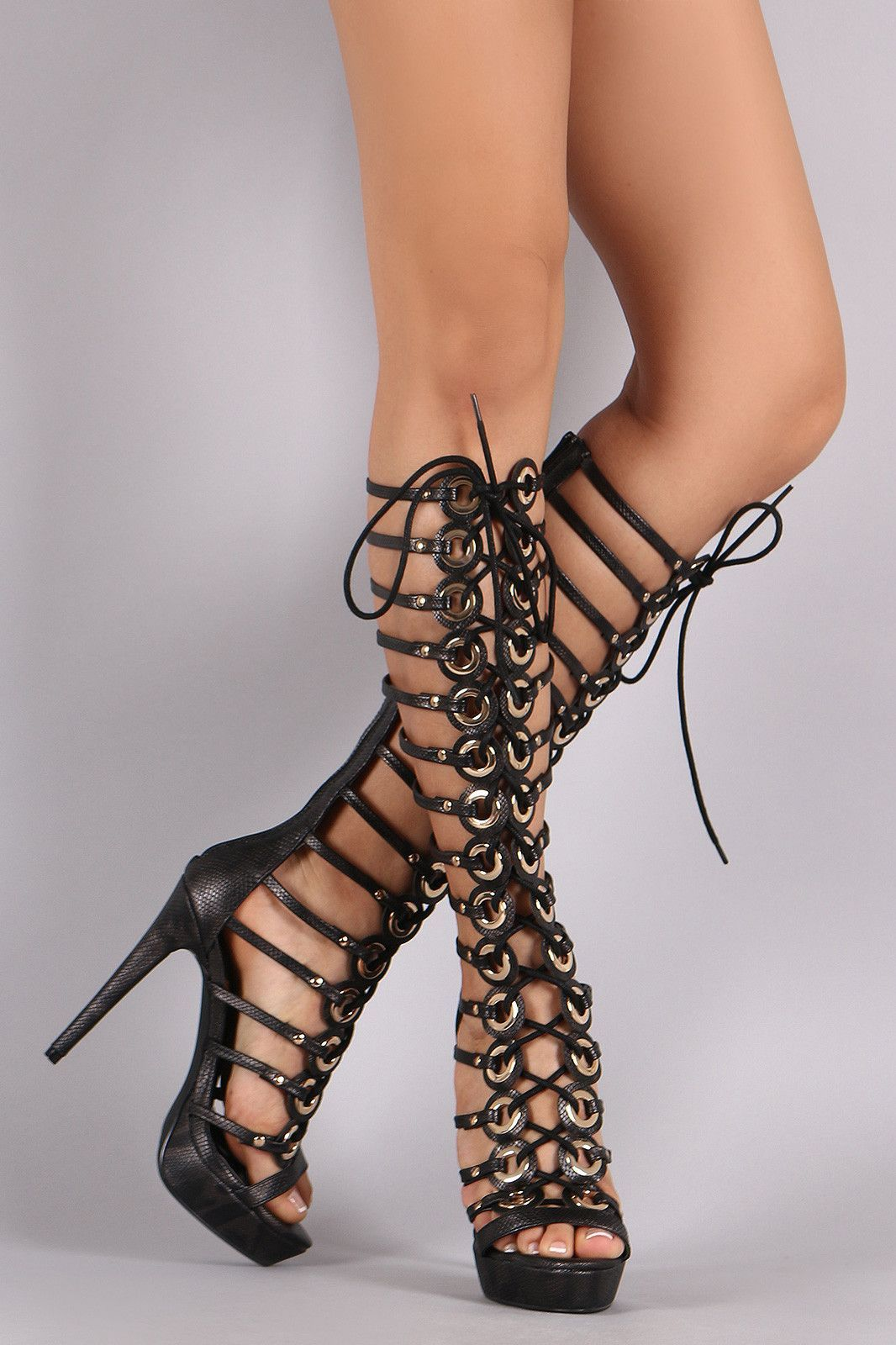 7e478efc475 This gladiator heel features a snake embossed