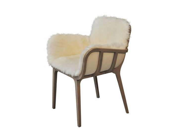 Jean-Marc GADY designs a new range called KAGO, named like the Japanese palanquins made of bambu plait upholstered with a cover of silk. <br />From this sedan chair, the designer kept the light frame in beech and the upholstery whose padding imitates the outside design. <br />Kago is a complete range with uncluttered lines making like a nest. A work achieved all in curves true to Perrouin's signature. <br />Other version: upholstered with a real sheep fur. Not only elegant, it is really…