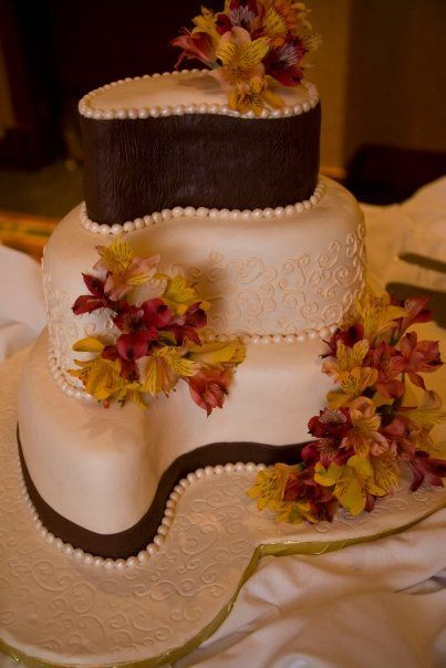 not a fan of traditional shaped wedding cakes.. not a fan of the color and decorations but love the uniqueness and style of it!
